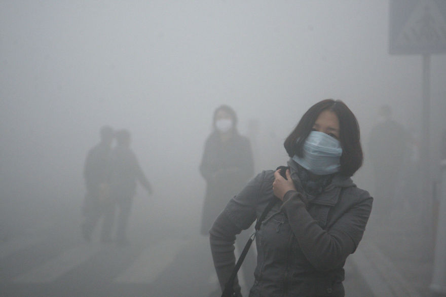 16. Girl Walks Through Smog In Beijing