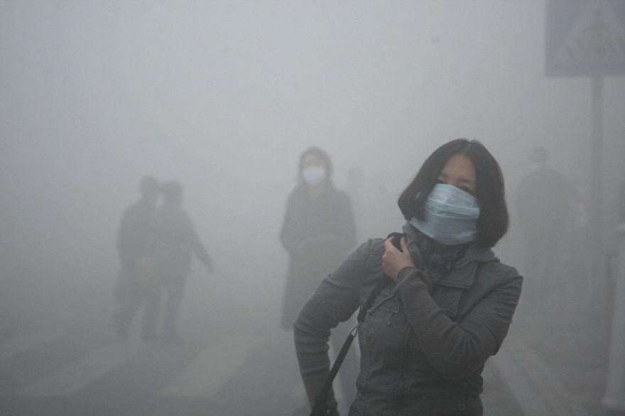16. Girl Walks Through Smog In Beijing