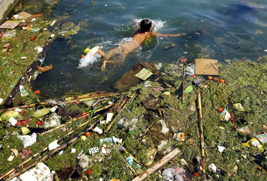 20. Child swinning in polluted reservoir
