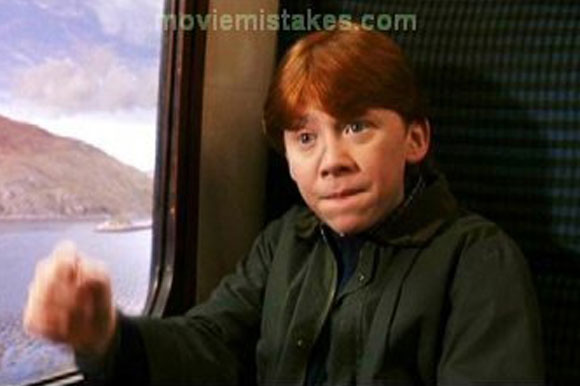 Ron's hair is parted in different ways