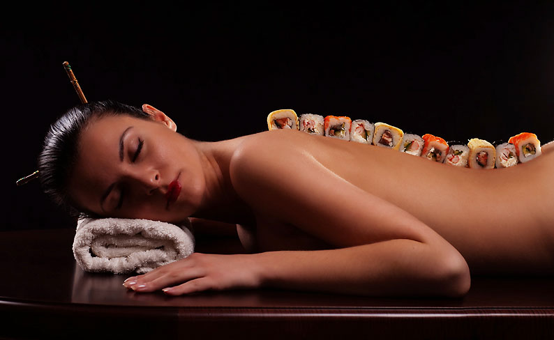 Models are used as sushi platters