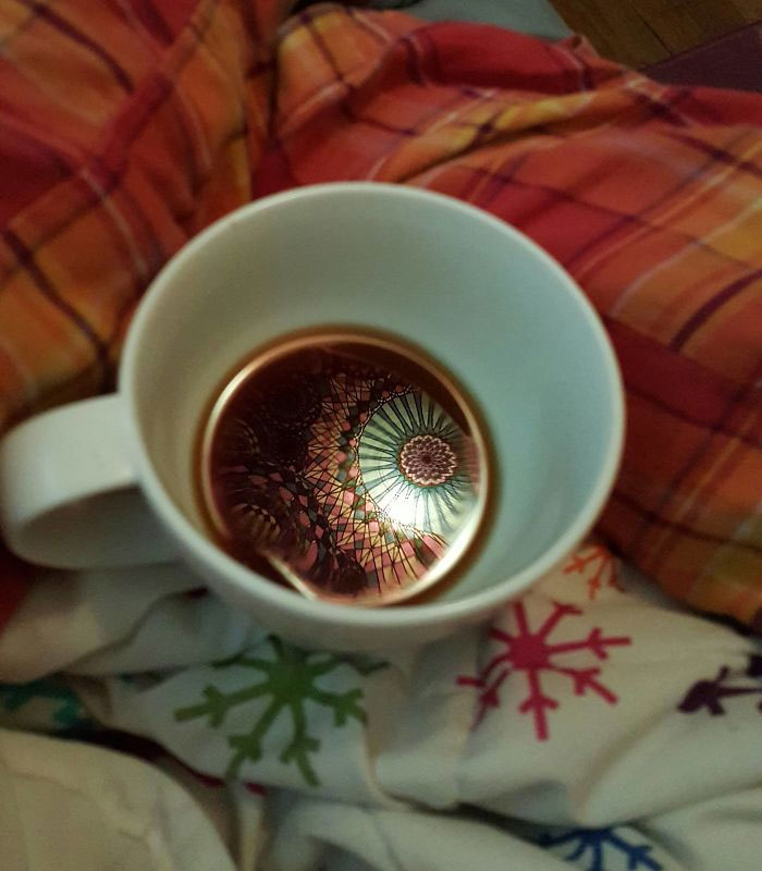 """The Tapestry Above My Bed Made A Pretty Sweet Reflection In My Coffee This Morning"""