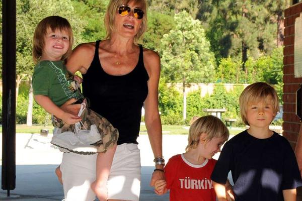 Sharon Stone has three handsome guys