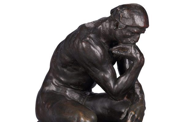 An extraterrestrial version of the Thinker Statue
