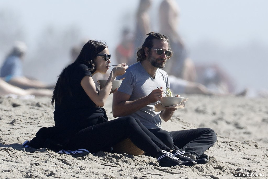 Irina and Bradley Cooper having a picnic on the beach